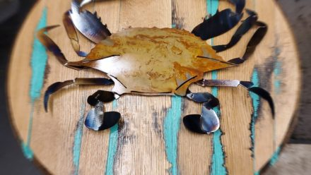 Blue crab on Whiskey Barrel Lid